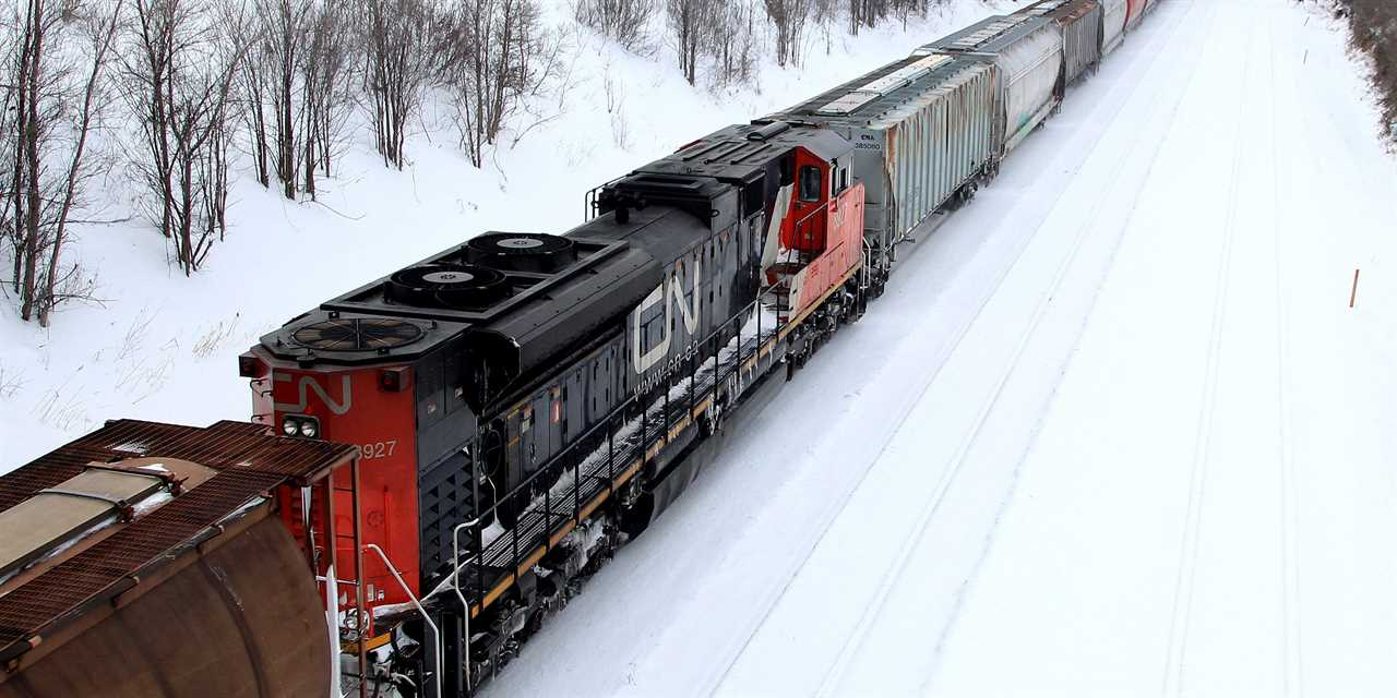 FILE PHOTO: A Canadian National Railway train travels eastward on a track in Montreal, February 22, 2015.. REUTERS/Christinne Muschi/File Photo